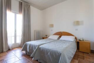 accomodation roumani hotel bedroom facilities